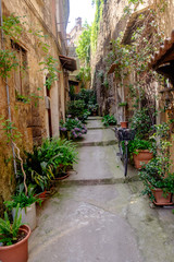 Fototapeta na wymiar A blind alley in the historic town of Sant'Agata de' Goti, Campania, Italy, is full of flowers and shows some authentic, charming character.