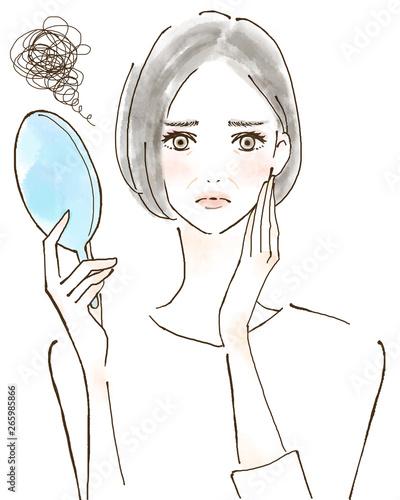 Fototapeta ほうれい線 シワ 紫外線トラブル 日焼けを気にする女性 美容 肌 obraz