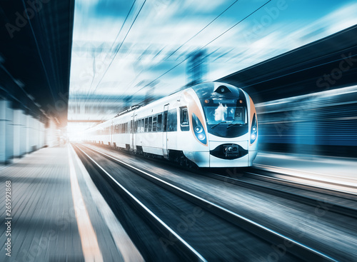 Fotografie, Obraz High speed train at the railway station at sunset in Europe