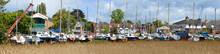 Woodbridge Panorama With Reeds And Boats In Yard.