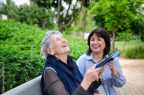 Papel de parede Senior woman is happy with the first success in using the tablet