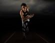 Leinwandbild Motiv Sporty young woman running