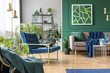 Real photo of green and blue living room interior