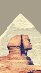 Fototapeta Architektura Egyptian Sphinx and Great Pyramid of Khafre (Chephren) in Giza - famous egyptian landmarks in Cairo. Background for travel catalog or design of vertical flyer for Egypt tour with place for your text.