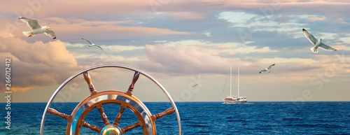 Fotografía  Marine landscape with a captain wheel, seagulls and yacht.