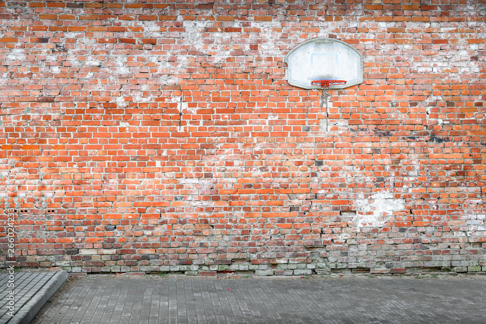 Fototapety, obrazy: Basketball court by a brick wall in Poland.