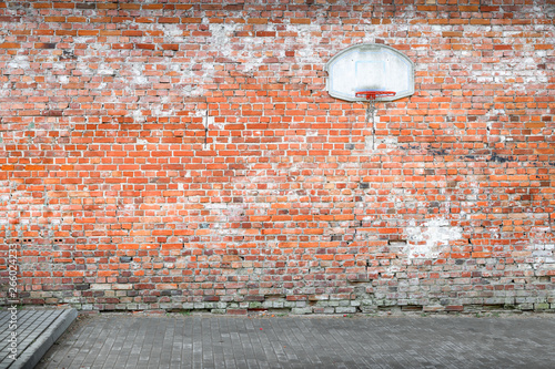 Fotografiet  Basketball court by a brick wall in Poland.