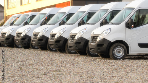 Photo commercial delivery vans parked in row