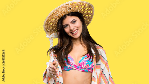 Teenager girl on summer vacation shaking hands for closing a good