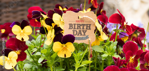 Papiers peints Pansies 'HAPPY BIRTHDAY TO YOU' – Text Tag in Colorful Bouquet of Beautiful Pansy Flower Petals. Horizontal Congratulations Card.