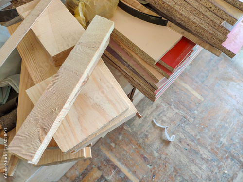 Fototapeta Cut wood pieces remaining from carpenter handcraft at furniture workshop, ready to recycle obraz na płótnie