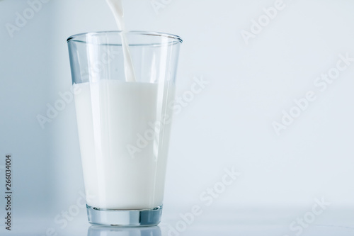 World Milk Day, pouring into glass on marble table