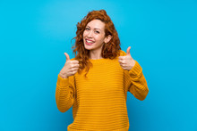 Redhead Woman With Yellow Sweater With Thumbs Up Gesture And Smiling