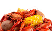 A Crawfish Boil With Corn On The Cob And Potatoes