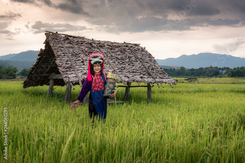 fototapeta na lodówkę Portrait of Woman Tribal Lisu in Traditional Clothing in Rice Fields, Tribes Lisu Wearing Beautiful Tradition Clothes and Stand Posing in The Rice Terrace. Cultural Lifestyle of Hill Tribe Woman