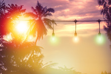 Blurred Light With Coconut Palm Tree Background On Sunset, Yellow String Lights Decor In Outdoor Restaurant