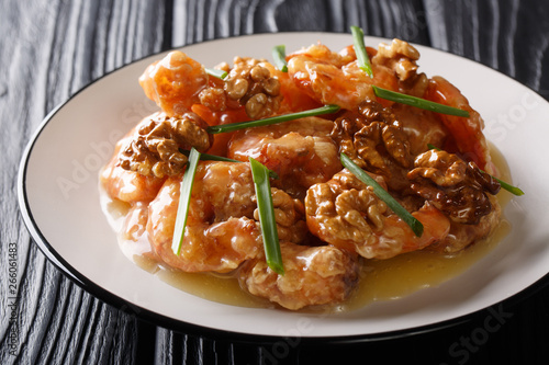 Fotografie, Obraz Crunchy shrimp with honey, candied walnut, and sweet mayo close-up