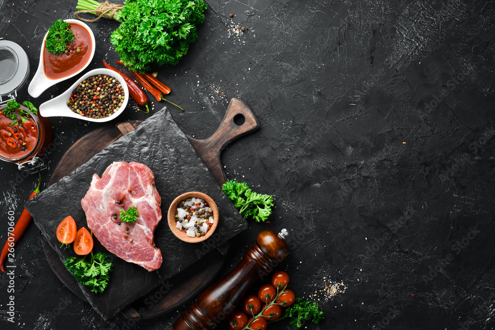 Fototapety, obrazy: Raw steak on the board. Meat. On the old table with spices and herbs. Top view. Free space for your text.