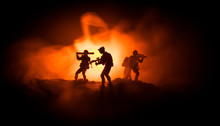 Military Soldier Silhouette With Gun. War Concept. Military Silhouettes Fighting Scene On War Fog Sky Background, World War Soldier Silhouette Below Cloudy Skyline At Night.