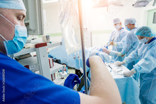 Foto op Canvas Pedicure Arthroscope surgery. Orthopedic surgeons in teamwork in the operating room with modern arthroscopic tools. Knee surgery.