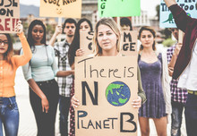 Group Of Demonstrators On Road, Young People From Different Culture And Race Fight For Climate Change - Global Warming And Enviroment Concept - Focus On Blond Girl Face