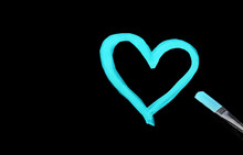 Bright Blue Heart Shape Painted With Watercolors On Black Paper