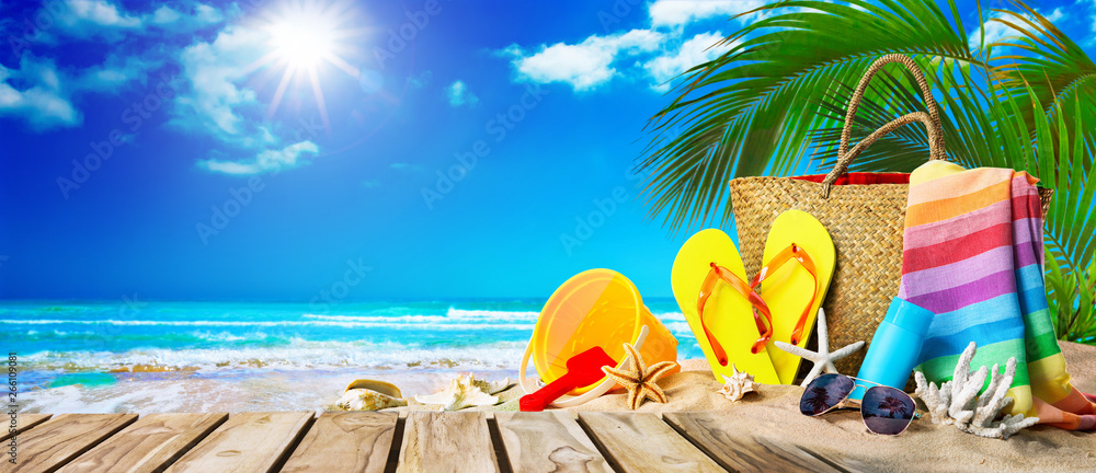 Fototapeta Tropical beach with sunbathing accessories, summer holiday background