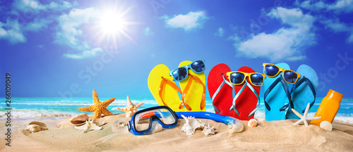 Tropical beach with sunbathing accessories, summer holiday background Fotobehang