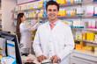 Leinwandbild Motiv Pharmacist standing at pay desk