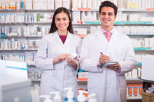 Two Pharmacists In Modern Pharmacy.