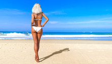 3D Beautiful Sun-tanned Woman White Swimsuit Bikini On Sea Beach. Summer Rest. Blue Ocean Background. Sunny Day. Conceptual Fashion Art. Seductive Candid Pose. Realistic Render Illustration.