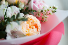 Yellow-orange Large Delicate Flower Surrounded By Small White And Pink Flowers In A Bouquet