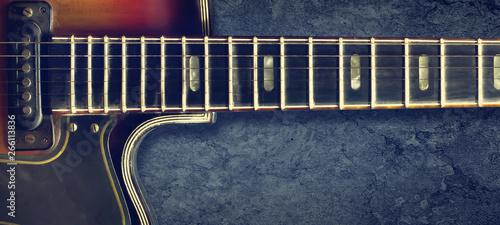 Fotografia Old jazz electro guitar on a dark background