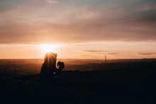 Girl Taking Photos During Colored Sunset In Quarry Hady Brno With View Inside City