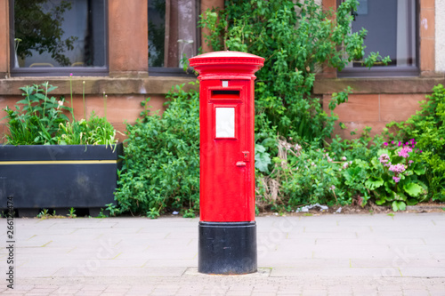 Canvas Print Traditional old red post box for mail and delivery of letters