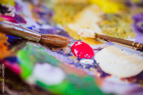 Painting artwork: paint brushes on painting background Wallpaper Mural
