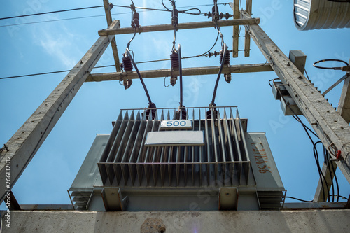 Electrical distribution transformer with high voltage cables