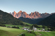Small Italian mountain town of St. Magdalena in Val di Funes at sunset