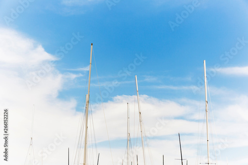 Valokuva  Yacht masts standing high in the sky.