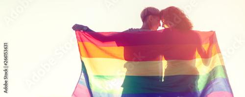 Valokuva Beautiful lesbian couple with rainbow flag