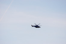 Police Helicopter In The Distance With Veil Clouds