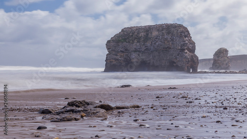 Poster Cote Marsden Rock and Beach, South Shields, Tyne and Wear, England, on a windswept day,