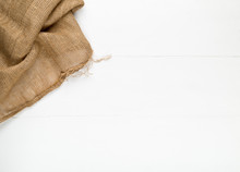 Burlap Fabric Cloth On White Wooden Kitchen Table With Copyspace