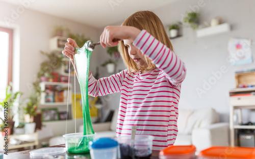 Stampa su Tela Little girl making homemade slime toy
