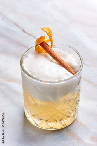 Stampa su Tela whisky sour alcohol cocktail with egg white, orange cedar and cinnamon
