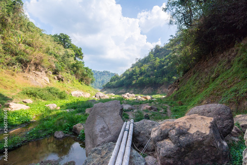 Fototapeten Forest river View of the path to the Chong Lom waterfall in summer at Nakhon Nayok, Thailand