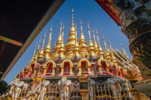 View A Group Of Small Golden Pagoda Mandalay Style With Blue Sky Background, Wat Phra That Suthon Mongkhon Khiri, Famous Attraction In Den Chai District, Phrae, Northern Of Thailand.