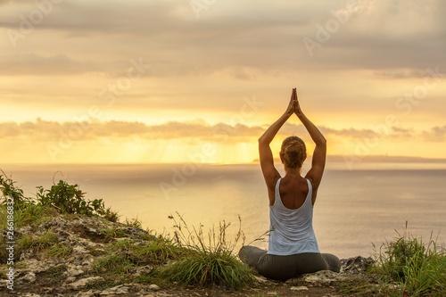 Obraz na plátně  Caucasian woman practicing yoga at seashore