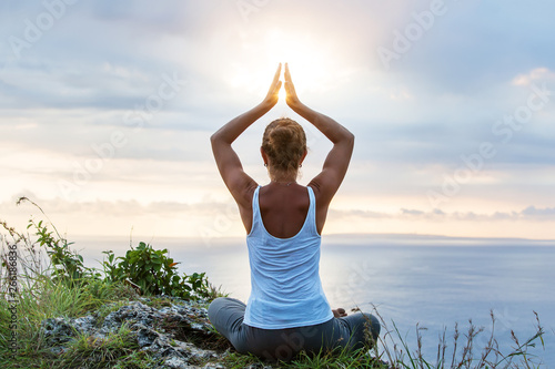 Valokuvatapetti Caucasian woman practicing yoga at seashore