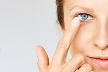 Young Woman Puts Contact Lens In Her Eye. Eyewear, Eyesight And Vision, Eye Care And Health, Ophthalmology And Optometry Concept